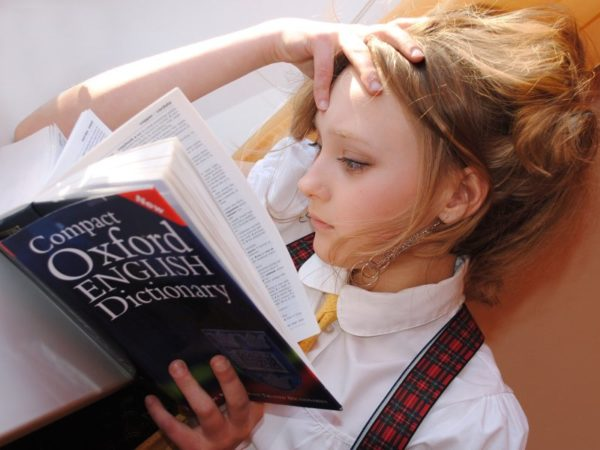 Girl Reading English Dictionary